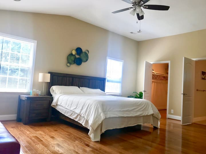 Master bedroom with three windows & natural light