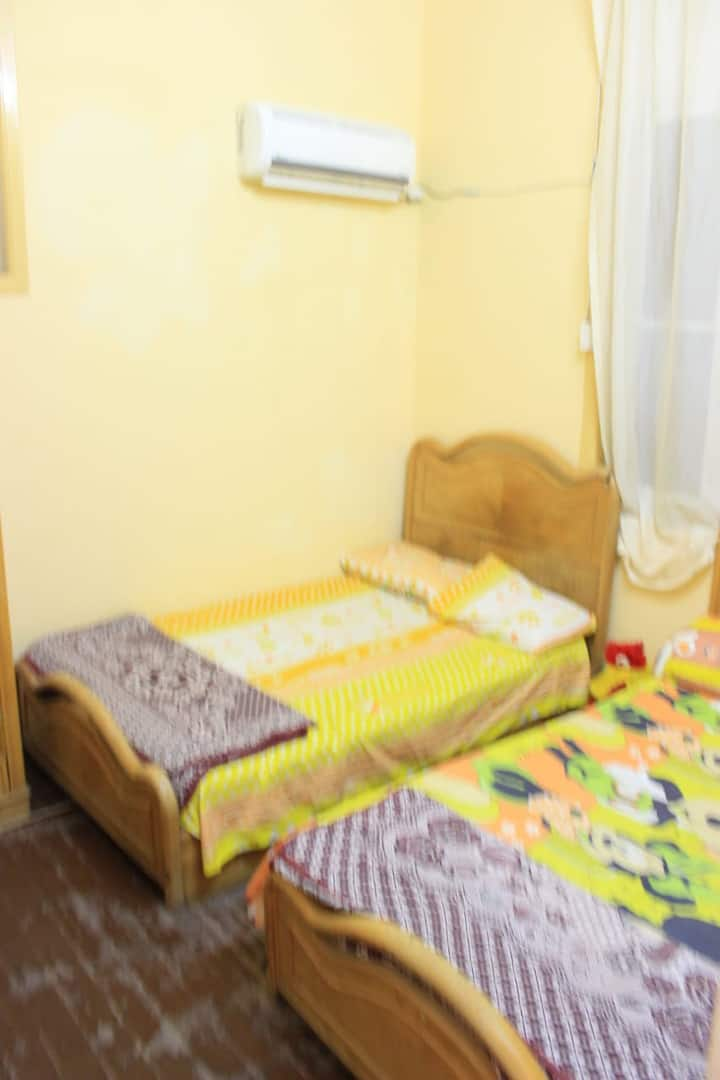 Single bed at Female Dormitory shared Bathroom B.B