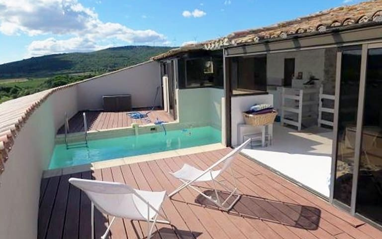 Roof terrace with pool and summer kitchen.