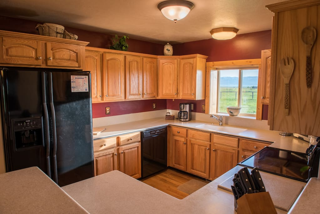 The kitchen not only provides a beautiful view of nature, but plenty of space for cooking and baking.