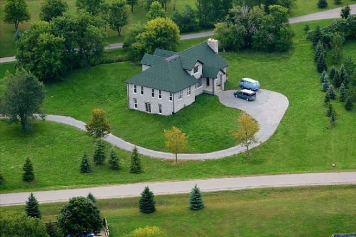 hospitable 5400 sq. ft. English-Style Stone House