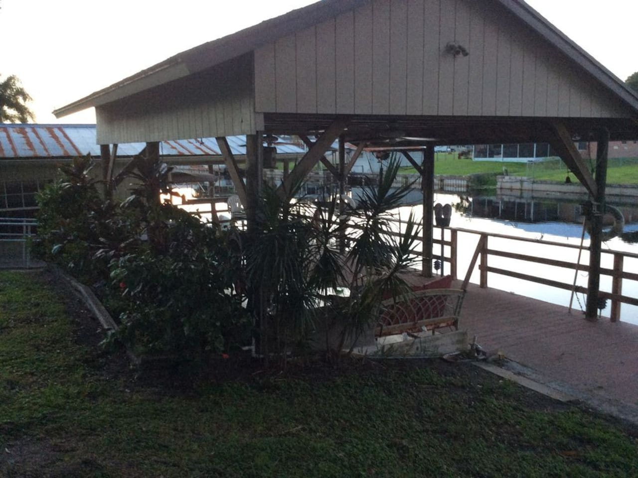 Covered dock w/boat slip, boat house & fish cleaning station.  Water & electric available.