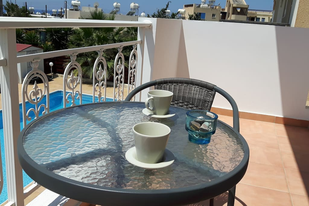 Our balcony facing the pool, ideal for a morning coffee or an evening glass of wine.