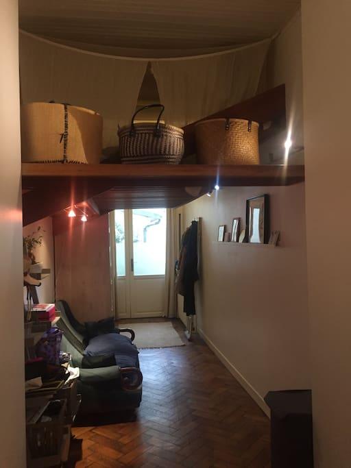 Corridor with mezzanine bed on top