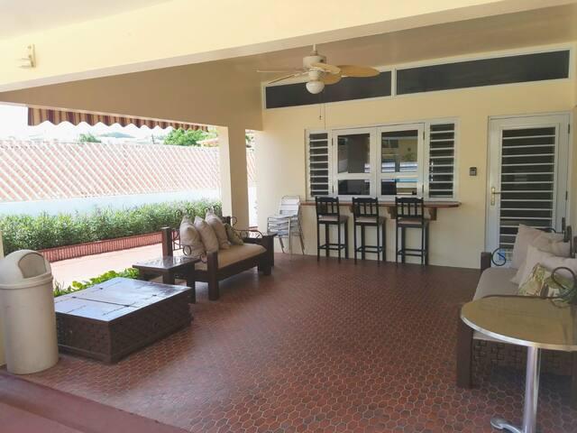 Outdoor living space & kitchen windows