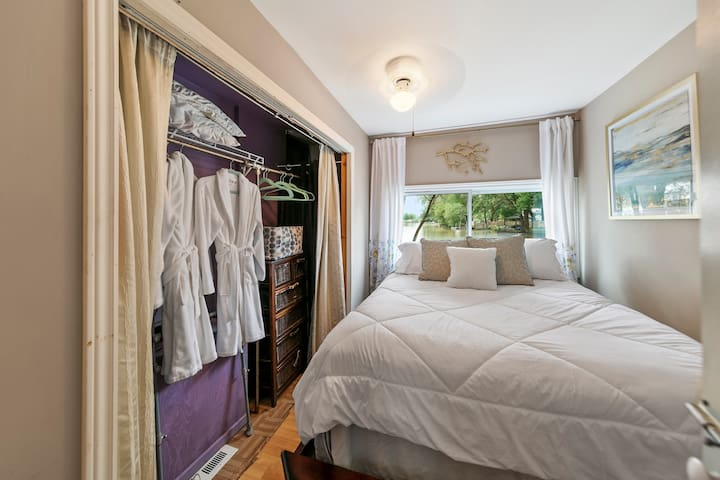 Queen bedroom with robes for your stay.