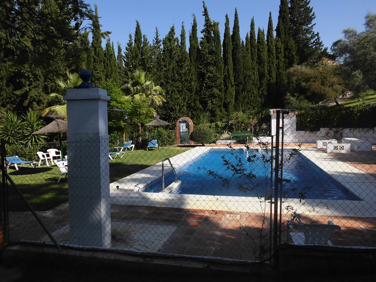 The residents only cummunal private Swimming Pool & Gardens.