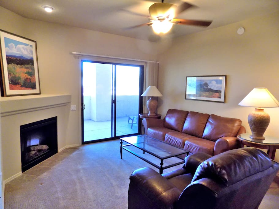 Welcome to our place, your home away from home. Comfortable living room with leather sofa and rocker recliner.