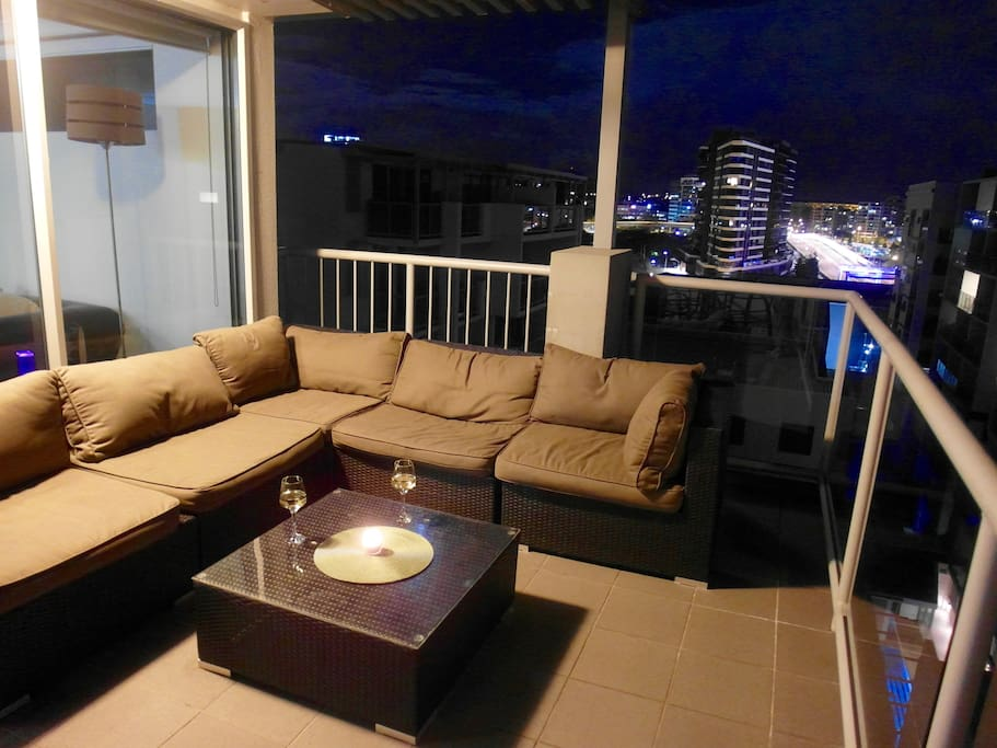 Enjoy the view from this large outdoor coach on the rooftop