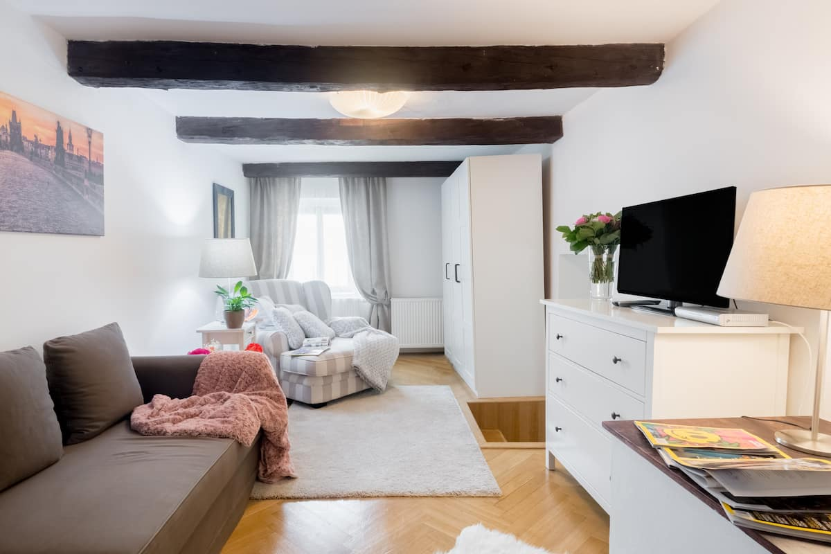 Retreat to a Romantic Nest in the Old Town Square