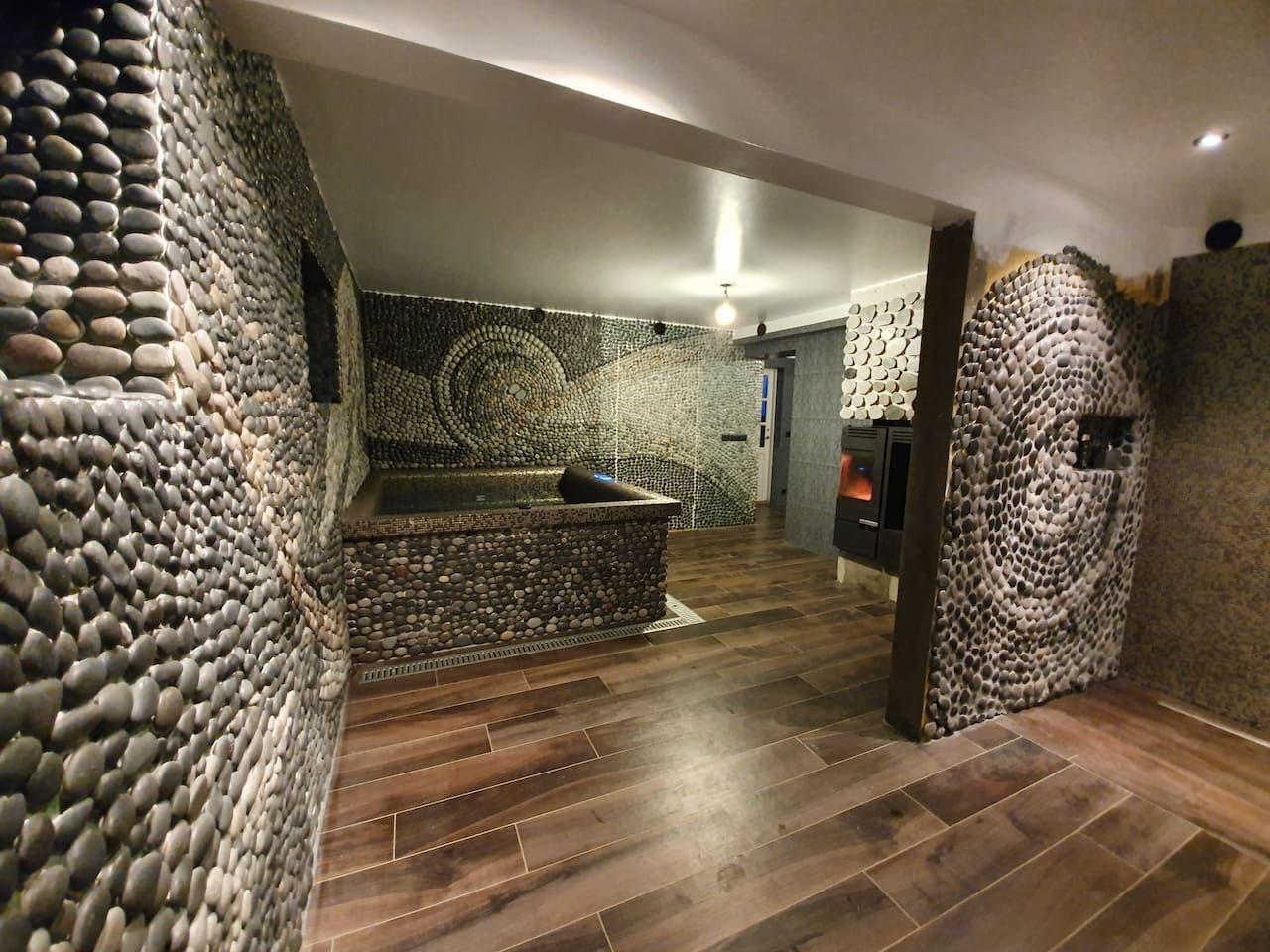 """Welcome to Önundarholt Spa apartment. Indulge your senses in the unique Mosaic spa, handcrafted and designed by the host. Every stone on the mosaic-wall """"The Voyage"""" was selected and handpicked by the artist himself."""