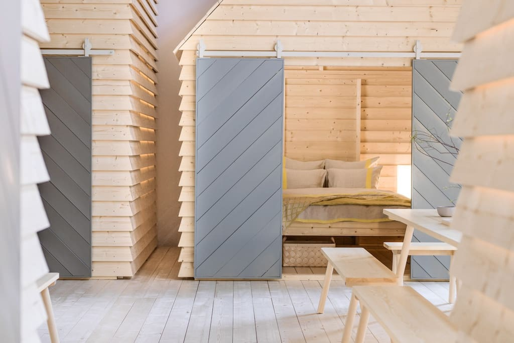 "KOTI (Finnish for ""home"") transforms the premises of Tori Quarters Sofiankatu 4 to bring the magic of the communal cottage experience in the very heart of Helsinki."
