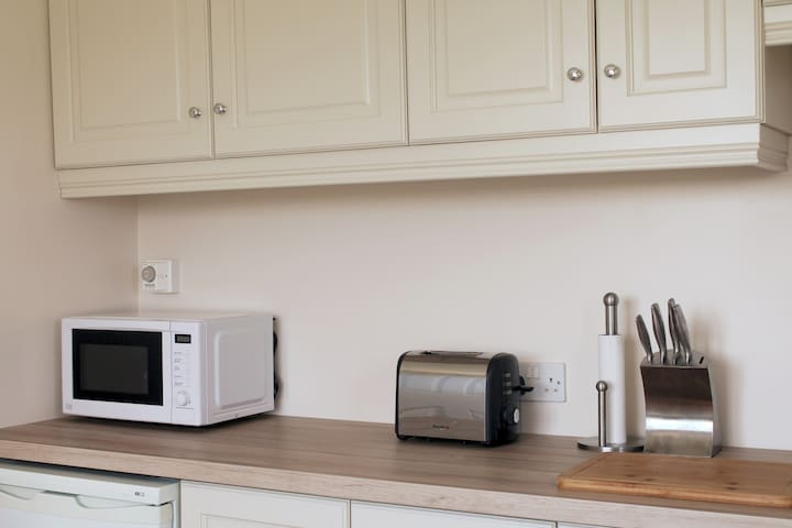 Fully equipped kitchen with cooker, fridge, microwave, kettle, toaster and coffee maker - everything you need for an enjoyable self catering experience