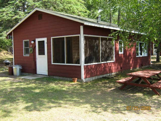 Cute knotty pine lakeside cabin with screen porch