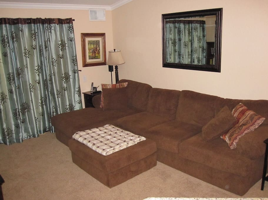 Full size couch with chaise lounge seat and ottoman