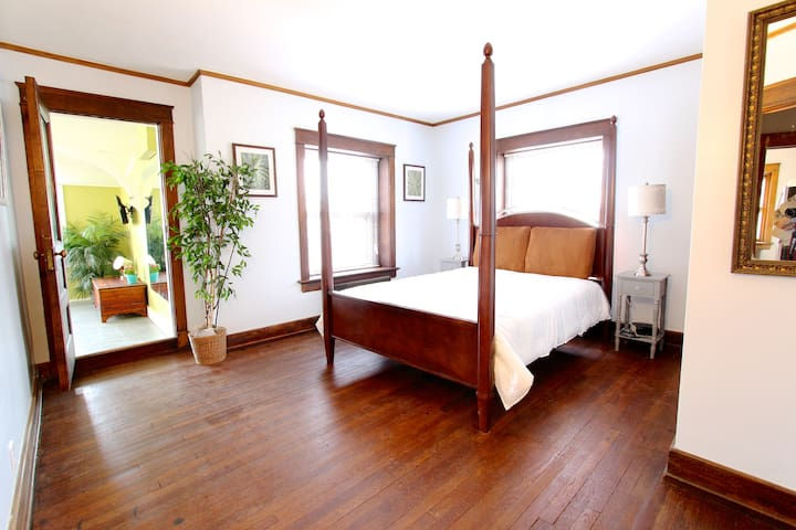 Relax in this beautiful expansive bedroom with lots of natural light