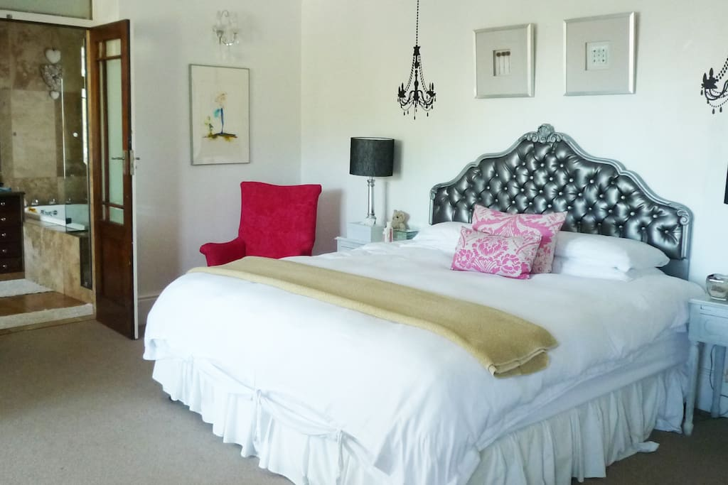 Huge Master bedroom opening onto a full length balcony and ensuite bathroom