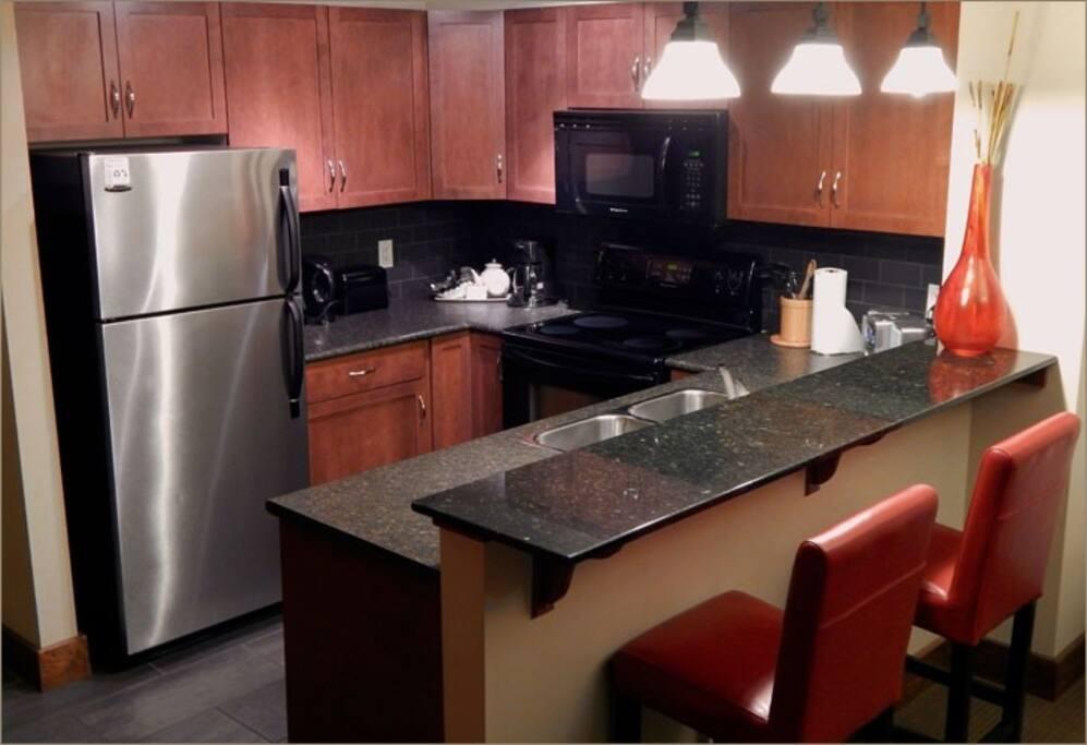 Modern, sleek kitchen with stainless steel appliances