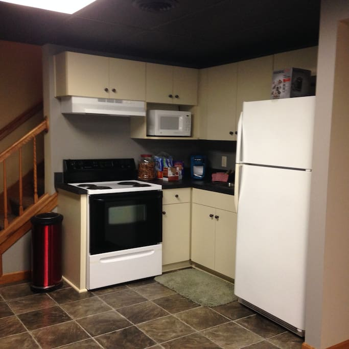 Kitchenette - Dishes, Stove, Sink, Microwave, Refrigerator