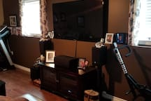 """Lower Level Living Room with Large TV and treadmill available and """"total crunch"""" abdominal machine available. Wii and some games available to use as well."""