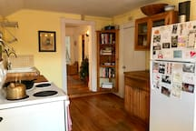 Kitchen with lots of natural light during the day. Fully stocked with pots, pans, an everything you'd need!