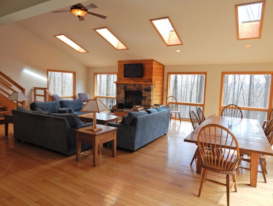 The large living space is perfect for spending time together. Warm natural light filers inside from the many large windows.