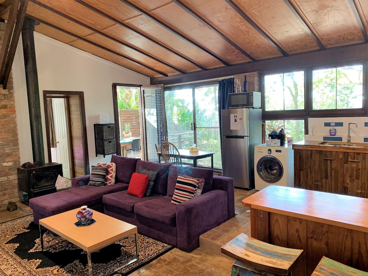 Living area opening out to a large North facing deck overlooking tropical gardens.