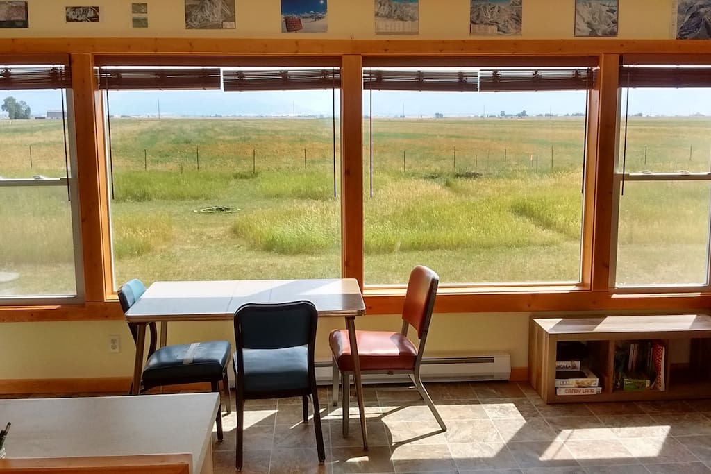Kitchen table with large windows viewing the Tetons