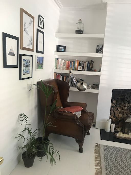 The snug as we affectionately call it. Extremely cosy during cold winter months but lovely and airy in the summer; boasting stylish plantation shutters, original fireplace, fireside chair with leg rest accompanied by lots of reading material.