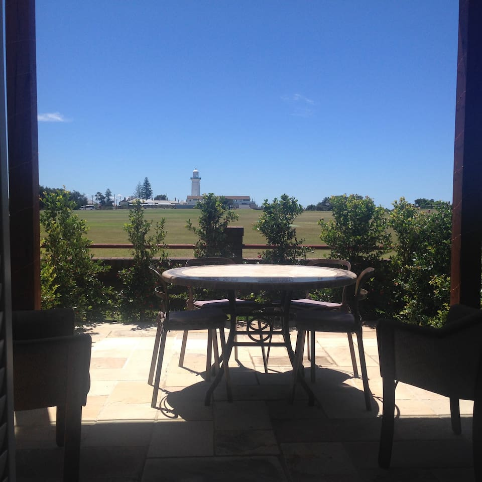 Views from sitting room and alfresco courtyard across Christison Park to Macquarie Lighthouse