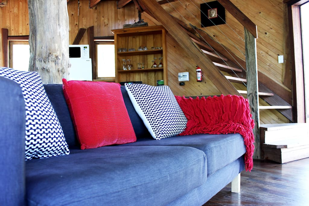 The lounge area ready to cosy up in front of the fire & tele