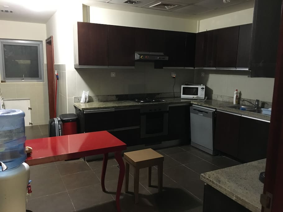 Large kitchen with a lot of utensils and dish washer
