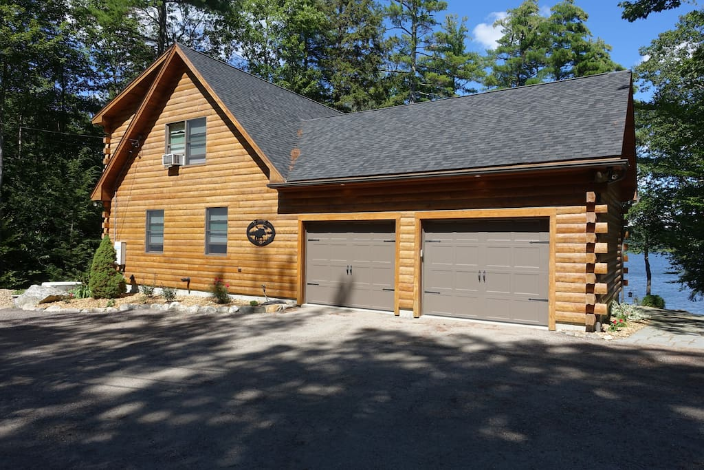 Just 15 minutes from downtown Portland, enjoy your time in Southern Maine on the shores of Highland Lake. Your parking spot is just there, to the right of the garage next to the stone path.