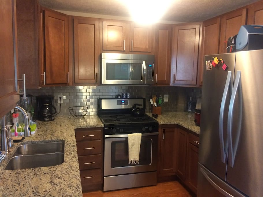 Kitchen with gas stove and new appliances