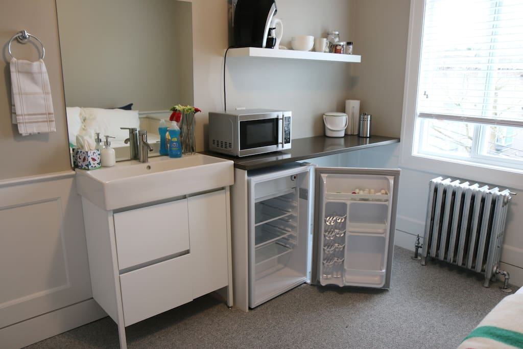 Typical set up with a personal sink, kitchenette that includes a mini-fridge, microwave and utensils.