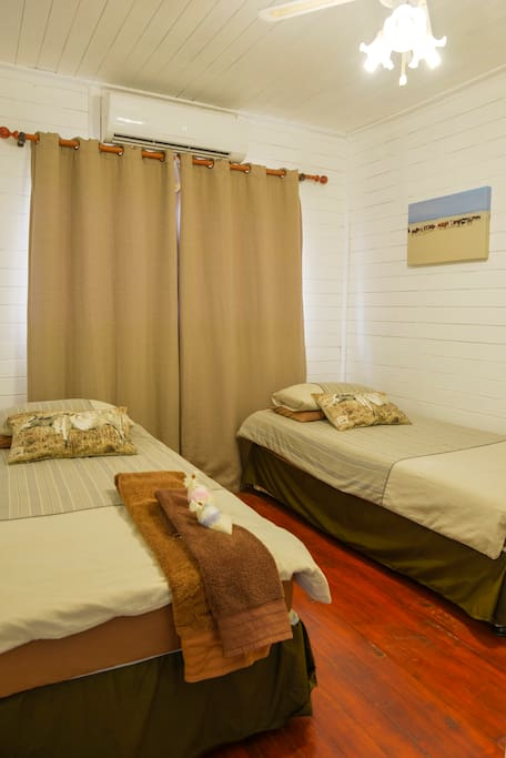 Bedroom with either 2 Single Beds or 1 Double Bed. Air Conditioned