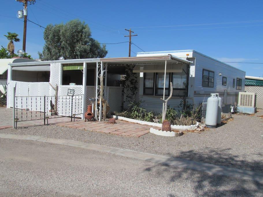 The home is  a cute 1 bedroom, 1 bath mobile home with enclosed patio.  88 Shades Park, Lot #7, Quartzsite, AZ