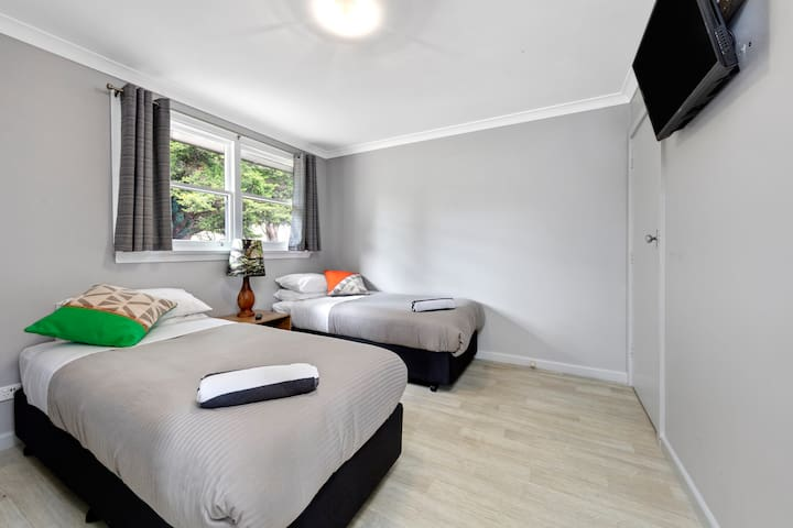 This is the twin room. The beds zip together on request to become a king bed. There is a second TV in here so the grown ups can sit in the kitchen/ dining and chat and the kids can hang in here and watch tv of a night or of course you can just watch tv in bed!