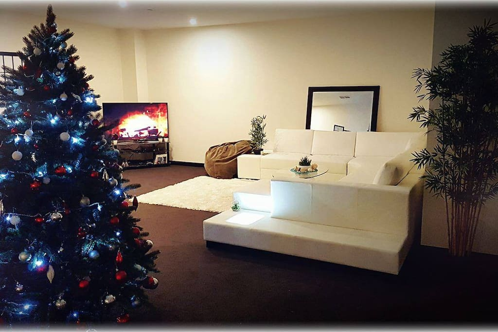 All this is your area of the apartment. Large relaxing space, beautiful wide leather couch and beanbags to relax and watch the wide screen TV