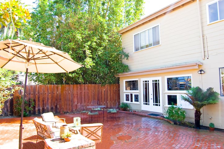 Backyard off the livingroom with table and seating area.