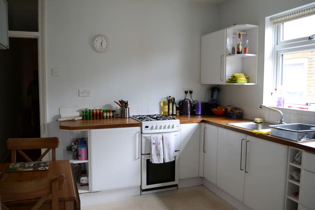 Kitchen with toaster, kettle and microwave for preparing snacks and re-heating food.