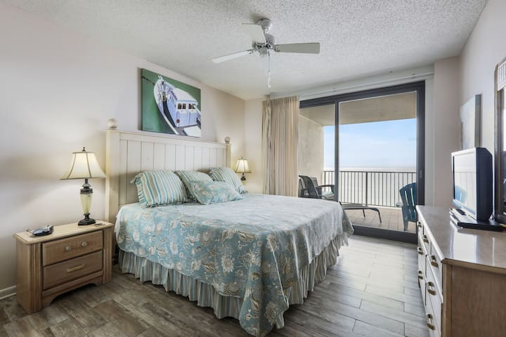 Master BR features a king bed, private bath, and balcony access.