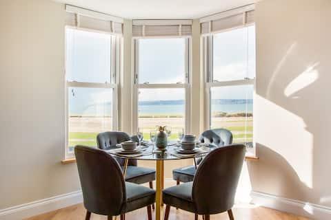 Stylish Beachfront Apartment with Castle & Sea Views