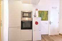 Fridge, oven and microwave. Washing machine with dryer