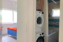In front of the bedroom and the first bathroom with washer and dryer.