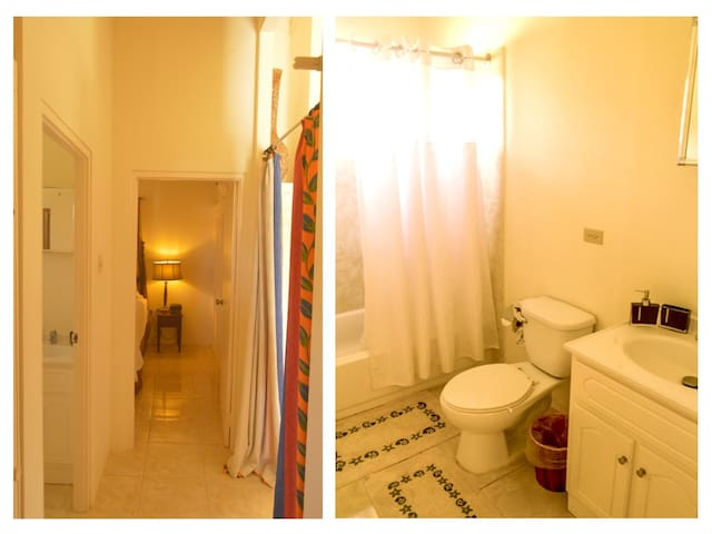 Bathroom equipped with full mirror and electrical outlets for shears, curling irons, blow dryers, full bath and shower