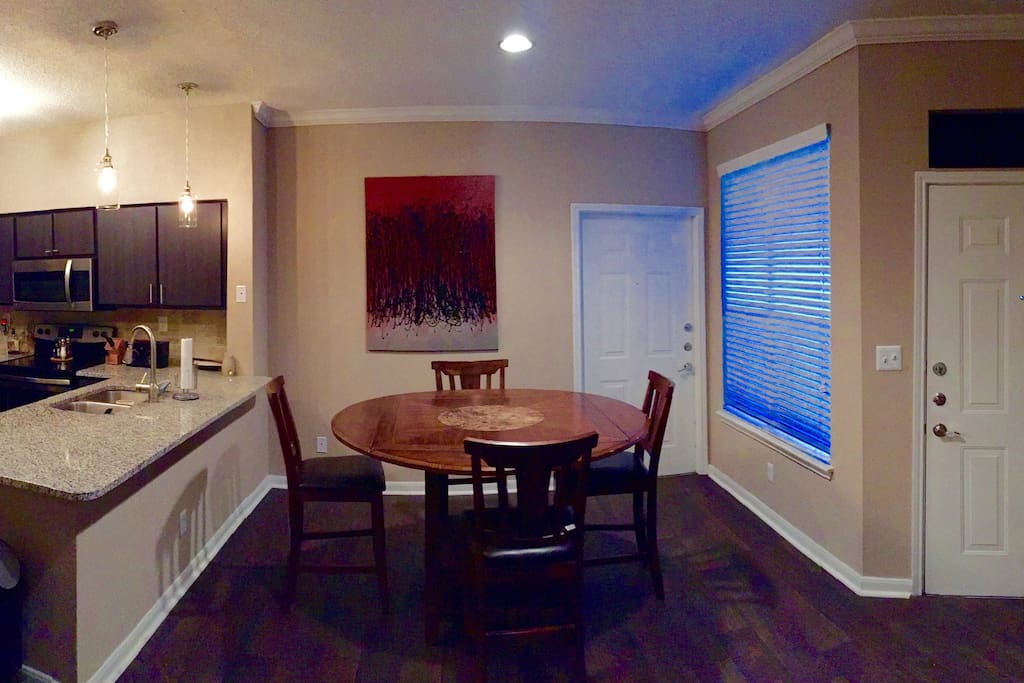 View of Dining Area with Door to Attached Garage
