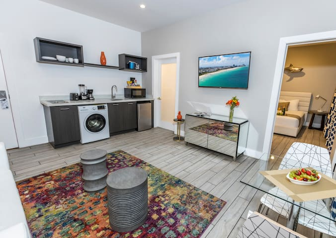 Mid-Beach Queen Bed Accommodation with Kitchenette and Sitting Area Near the Beach
