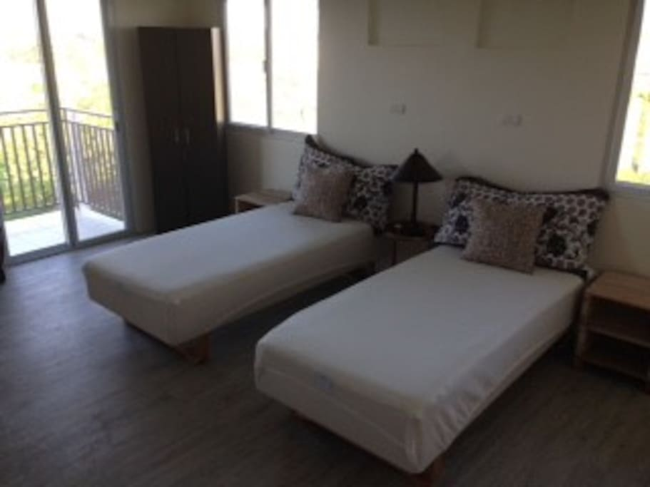 Two single beds with comfortable mattresses, adhering to body contour.