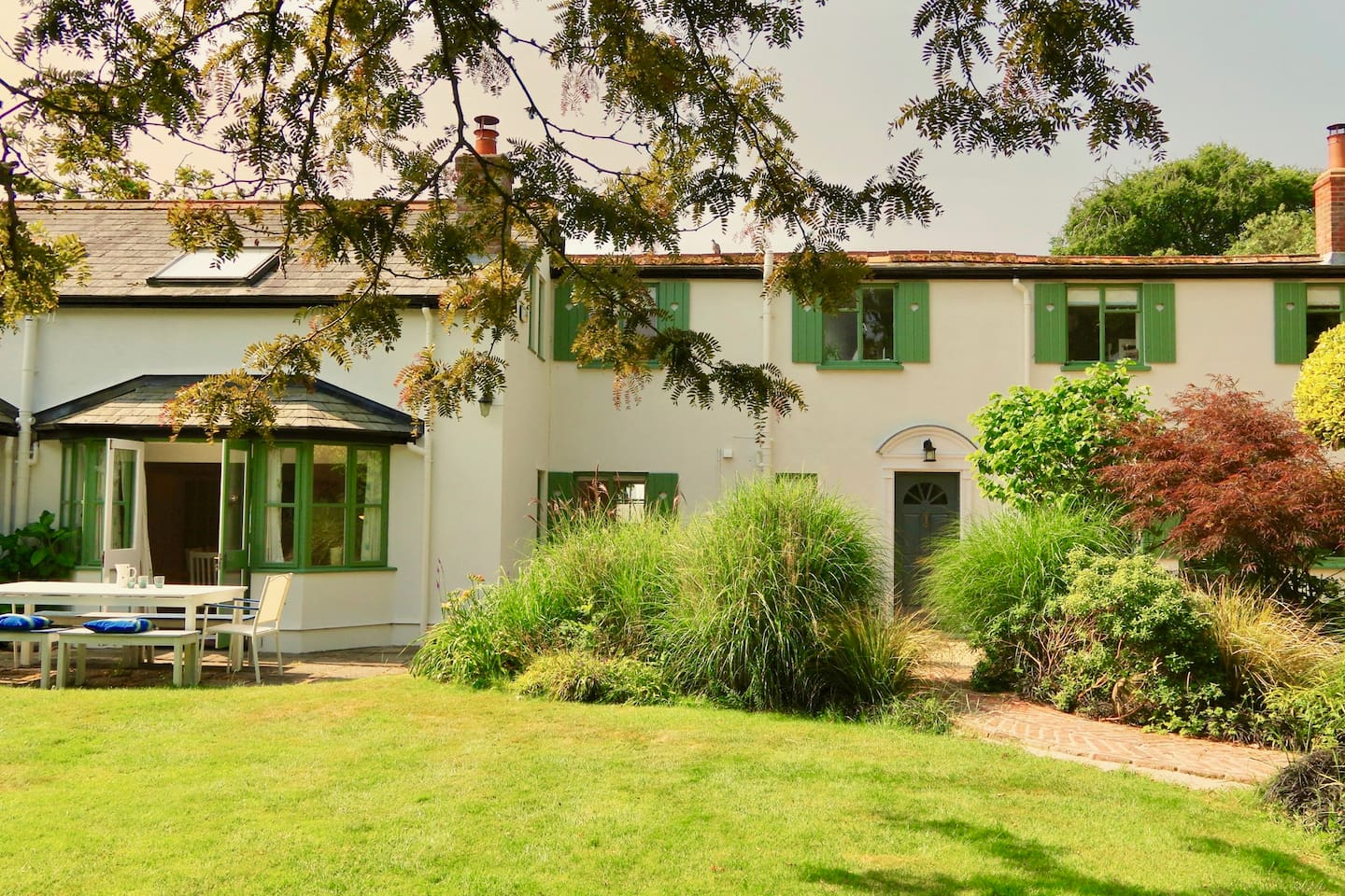 Set in the lush grounds of the renowned Apple Court Gardens